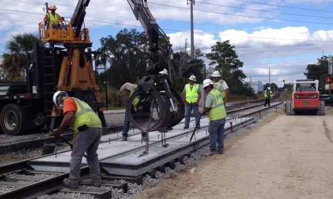 Archer Western crews will begin site-preparation work along the Miami-to-West Palm Beach rail corridor later this month. Here, they perform grade-crossing work for the SunRail project.  (Photo: Business Wire)