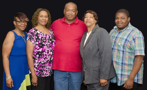 Boyd Transportation professional driver Johnnie Cobb (at center) enjoys the company's accolades for achieving 3 million consecutive safe miles while driving for Boyd. Johnnie's family joined him in the celebration at the company's headquarters. From left to right are: daughter, Artisha Richmond; wife, Annette Cobb; mother-in-law Princella Echols; and grandson, Jarnard Richmond. (Photo: Business Wire)