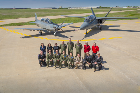 USAF Test Pilot School and Textron Aviation test pilots, instructors and support crew appear with the Scorpion and AT-6, April 22, 2015. (Photo: Business Wire)