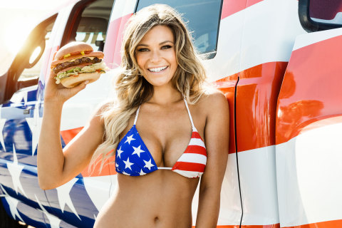 All-American model and Sports Illustrated 2014 Swimsuit Issue Rookie of the Year Samantha Hoopes stars in the patriotic new ad for the Most American Thickburger from Carl's Jr. and Hardee's, available beginning May 20, 2015. (Photo credit: Fab Fernandez and CKE Restaurants)