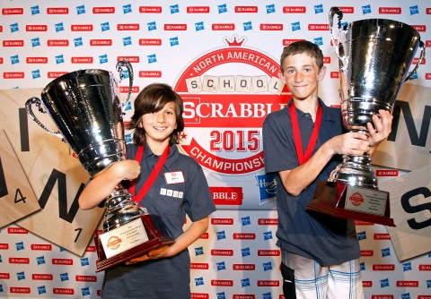 Teammates Noah Kalus, right, from New Paltz, N.Y. and Zach Ansell, left, from Los Angeles, Calif., pose for photos after winning the 2015 North American School SCRABBLE Championship, at Hasbro headquarters in Pawtucket, R.I., Sunday, May 17, 2015. Kalus and Ansell won, 587 to 331, over a team from Chapel Hill, N.C. (Stew Milne/AP Images for Hasbro)