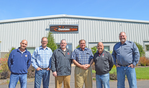 Shown, left to right, are: Bob Lively, Sales Application Engineer, Sutphen; Wayde Kirvida, Factory S ...