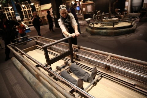 A visitor to The International Exhibition of Sherlock Holmes uses interactive displays to help solve a crime mystery. The exhibition opens to the public on June 11, 2015 at Discovery Cube OC in Santa Ana, California. (Photo: Business Wire)