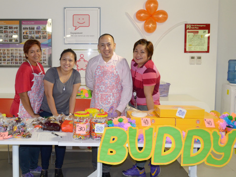 Wells Fargo Team Members selling candies and food stuff for their colleagues during the Fundraising