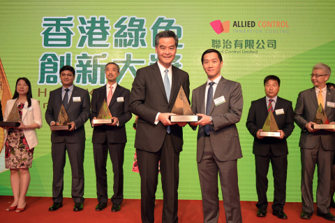 Kar-Wing Lau, VP of Operations at Allied Control with an award. (Photo: Business Wire)