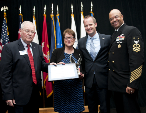 Stephen M. Koper (left), chairman of the Ohio ESGR presents the 'Above and Beyond' award to Paula De