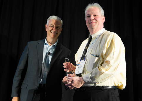 Michael Gruich, chief information officer for the Third Judicial Circuit of Michigan, accepts a Tyler Excellence Award from Bruce Graham, president of Tyler's Courts & Justice Division. (Photo: Business Wire)
