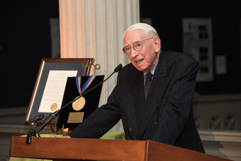 Dr. Luther W. Brady speaking at the President's Medal ceremony at George Washington University. Phot