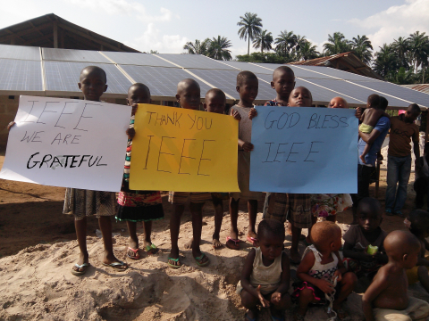 Children in Nigeria show their appreciation for IEEE Smart Village, which has brought clean energy and electricity to their community. (Photo: Business Wire)