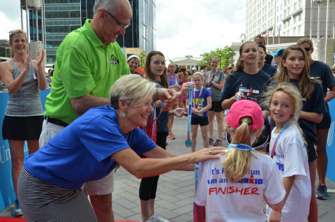 The first UnitedHealthcare IRONKIDS Raleigh Fun Run raced around the Raleigh Convention Center today. (From left to right) County Commissioners Caroline Sullivan and Sig Hutchinson, and Anita Bachmann of UnitedHealthcare handed out medals to more than 200 local youth as they crossed the finish line. Photo Credit: Marc Kawanishi