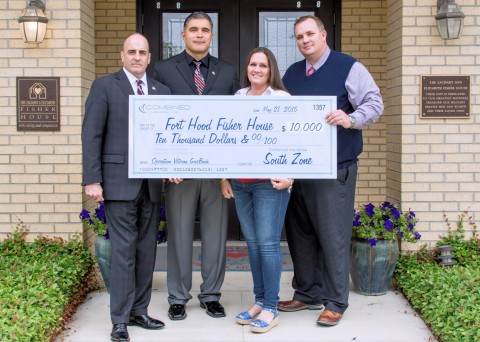 Combined Insurance's South zone sales and military hiring program executives present the Fort Hood Fisher House in Fort Hood, Texas, with a $10,000 donation. (l to r): Art Kandarian, retired U.S. Army Colonel and vice president of sales and military markets, Combined Insurance; Clemente Torres, territory manager, Combined Insurance; Theresa Johnson, manager, Fort Hood Fisher House; Greg Busse, market director, Combined Insurance. (Photo: Business Wire)