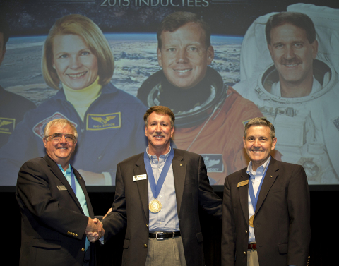 Astronaut Dan Brandenstein and Kennedy Space Center Director, Bob Cabana, welcome 2015 AHOF Inductee, Kent Rominger, into the U.S. Astronaut Hall of Fame Induction. (Photo: Kennedy Space Center Visitor Complex)