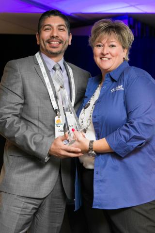 Bernalillo County Deputy Assessor Damian Lara accepts a Tyler Technologies Excellence Award from Kim