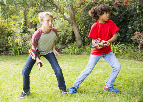 Image of children playing with Playmation Marvel's Avengers, which will be available at mass and specialty retailers, select Disney Stores and disneystore.com in the US and Canada starting October 2015. Playmation, the next step in the evolution of play, was unveiled by Disney Consumer Products for the first time on Tuesday, June 2, 2015. (Photo: Business Wire)