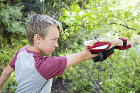 Image of a child playing with the Repulsor Gear, part of the Playmation Marvel's Avengers Start Pack, which will be available at mass and specialty retailers, select Disney Stores and disneystore.com in the US and Canada starting October 2015. Playmation, the next step in the evolution of play, was unveiled by Disney Consumer Products for the first time on Tuesday, June 2, 2015. (Photo: Business Wire)