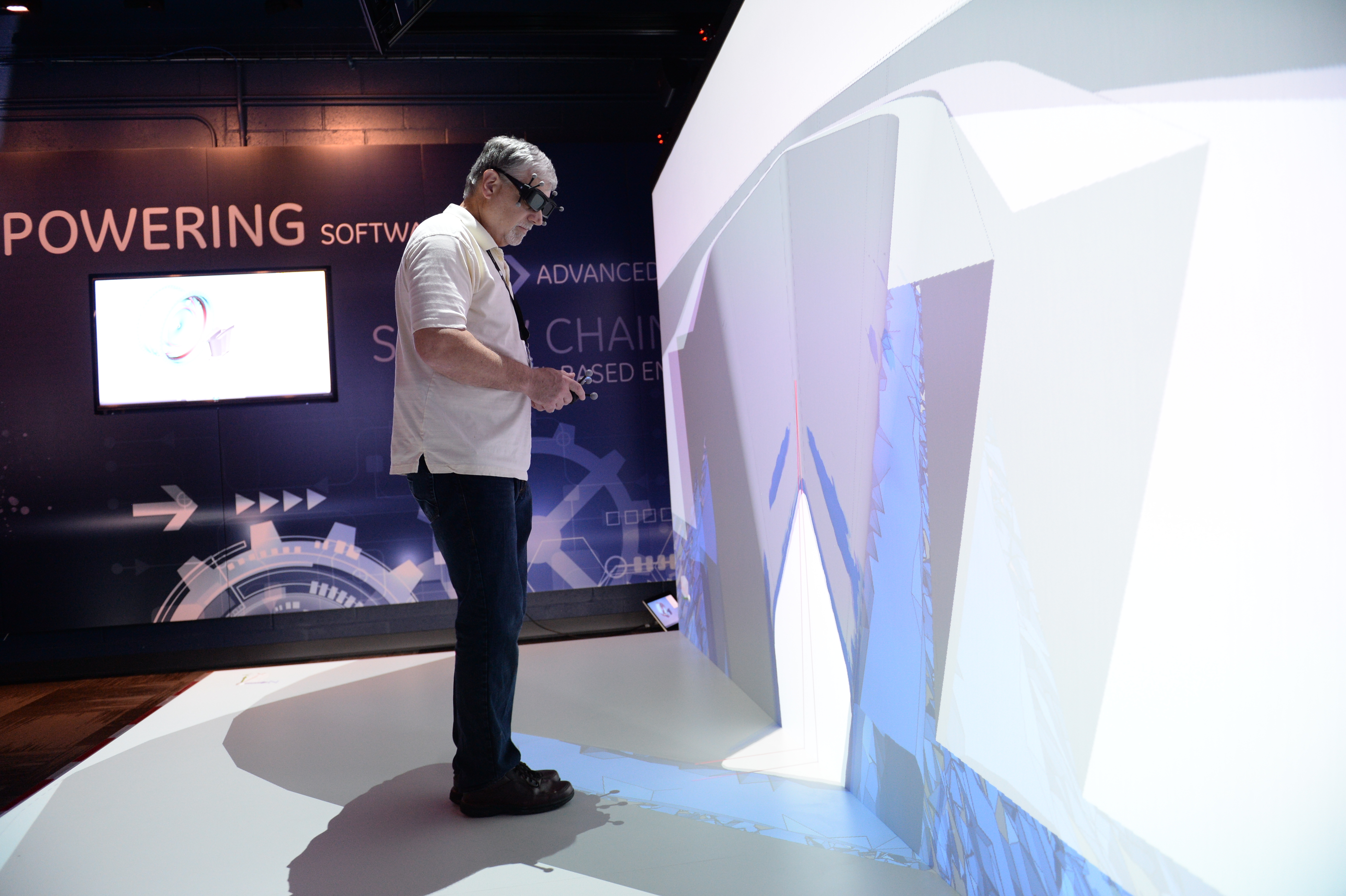 Virtual engineering - with digital tools, manufacturing and design engineers can study parts and the manufacturing processes for those parts virtually before you even have a final prototype part using three dimensional views like the one pictured in GE's Brilliant Factory Lab. Here, one of GE's manufacturing specialists examines a test part.