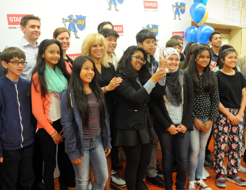 "Sasha Barausky, back left, Director of Product Management at Staples, and Ailene Mitchell, center left, Principal at Middle School 88, join students to celebrate a $50,000 product donation to create an innovation lab at MS 88, Wednesday, June 3, 2015, in the Brooklyn borough of New York, after the students participated in Staples' first-ever ""Designed by Students"" program. (Photo by Diane Bondareff/Invision for Staples/AP Images)"