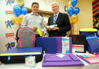 """Sasha Barausky, left, Director of Product Management at Staples, and Kirk Saville, right, Vice President, Global Communications at Staples, explore products from Staples' first-ever """"Designed by Students"""" program, which gave students a chance to create and design school products that solve real-life problems, Wednesday, June 3, 2015, at a school in the Brooklyn borough of New York. (Photo by Diane Bondareff/Invision for Staples/AP Images)"""
