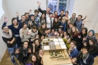 Members of a U.S. Department of Energy Solar Decathlon team representing students at universities in Austin, Texas, and Munich, Germany, demonstrate their enthusiasm to be one of 17 teams vying in the competition. (Photo: Business Wire)