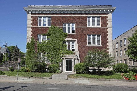 Exterior photograph of an historic Stevens Square apartment building, located at 1926 Third Avenue South in Minneapolis. UnitedHealth Group is providing $1.9 million in equity through a partnership with MEF to help transform the 100-year-old property into a new 19-unit affordable-housing community with support services for area homeless and people in need of permanent housing (Photo: Greg Page).