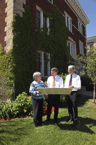 (L to R) Lee Blons, executive director, Beacon Interfaith Housing Collaborative, Tom McGlinch, vice president, investment management, UnitedHealth Group, and Warren Hanson, president and CEO of Minnesota Equity Fund review plans and view construction progress on an historic Stevens Square apartment building, located at 1926 Third Avenue South in Minneapolis. UnitedHealth Group is providing $1.9 million in equity through a partnership with MEF to help transform the 100-year-old property into a new 19-unit affordable-housing community with support services for area homeless and people in need of permanent housing (Photo: Greg Page).