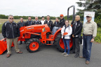 Left to right: Michael O'Gorman, Executive Director, Farmer Veteran Coalition; Tim Voss, Sr., Tri-State Rentals; Tim Voss, Jr., Tri-State Rentals; Buck Trawick, Director of Marketing, Kubota Tractor Corporation; Command Sergeant Major Rob Whittle, Kubota and U.S. military representative; Todd Stucke, Kubota Vice President of Sales, Marketing and Product Support; Dan Jones, Kubota Vice President, Human Resources, Legal and Administration; Matt and Deanna Soldano, Southtown Farms; Mr. Masato Yoshikawa, Kubota President and CEO; and Douglas Fisher, New Jersey Secretary of Agriculture. (Abbreviated: Kubota and Farmer Veteran Coalition representatives with Matt Soldano, the first farmer veteran awarded a Kubota tractor through the 'Geared to Give' program.) (Photo: Business Wire)