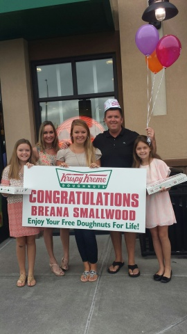 Breana Smallwood of Fuquay Varina, NC claims the grand prize of Doughnuts for Life from Krispy Kreme. (Photo: Business Wire)