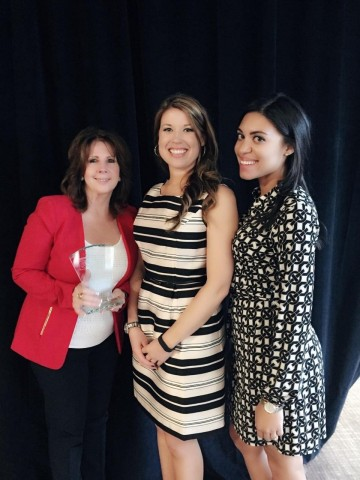 Pattie Fincham, Holly Urquhart and Kristin Herbert-Nicholson, Avnet Government Solutions, accept the