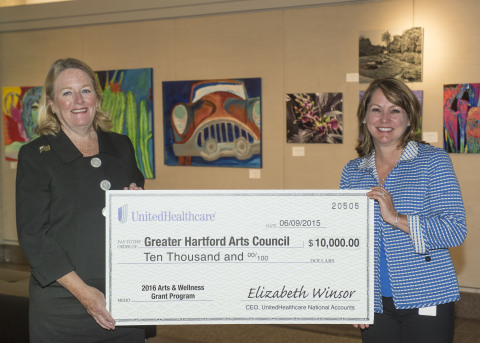 """Elizabeth Winsor, CEO, UnitedHealthcare National Accounts (right), presented Cathy Malloy, CEO, Greater Hartford Arts Council, with a check for $10,000 to support the 2016 """"Arts & Wellness"""" grant program, which funds artistic programs that use creativity as a tool to enrich lives and enhance the health and well-being of veterans and their families. The presentation was made at the 100 Pearl Street Gallery, which is managed by the Arts Council, where the """"Veterans Art Fund: Healing Through Arts"""" exhibit is currently on display through July 17 (Photo: Alan Grant, Digital Creations)."""