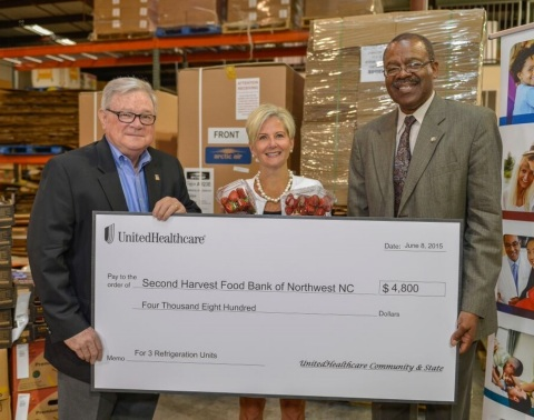 Anita Bachmann of UnitedHealthcare (center) presents a check for three refrigeration units to Clyde Fitzgerald, executive director, Second Harvest Food Bank of Northwest North Carolina (left) and Representative Ralph C. Johnson (District 58) during a special presentation at Second Harvest Food Bank. With more than 340 food deserts across 80 counties in the state, limited access to nutritious foods is a major issue statewide and particularly in the Triad. UnitedHealthcare has partnered with organizations like the Second Harvest Food Bank to reduce food insecurity across North Carolina and help people live healthier lives (Photo: Pam Brackett).
