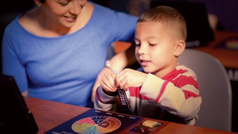 A family uncovers new flavor possibilities by using Hershey's tasting wheel. (Photo: Business Wire)
