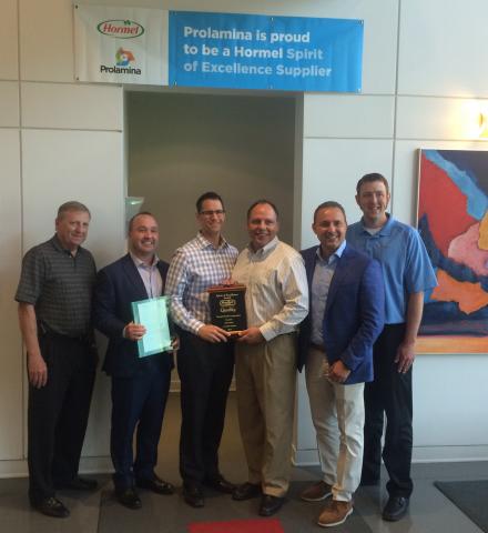 Hormel Foods and Prolamina executives with the 2014 Hormel Spirit of Excellence Award at Prolamina's ...