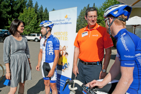 (L-R) Healdsburg resident and UnitedHealthcare Children's Foundation Board Member Jennifer Roberts meets with UnitedHealthcare ProCycling Team member Lucas Euser at the inaugural Velo & Vines Century Bike Ride. The event is raising funds for the UnitedHealthcare Children's Foundation. The foundation provides medical grants to help children gain access to health-related services not covered, or not fully covered, by their parents' commercial health insurance plan. Last year, UHCCF awarded about $5.4 million in medical grants to more than 2,000 children across the country. Also featured in the picture is Matt Peterson, President, UnitedHealthcare Children's Foundation and UnitedHealthcare Pro Cycling Team member John Murphy. (Photo credit: Amy Sullivan)
