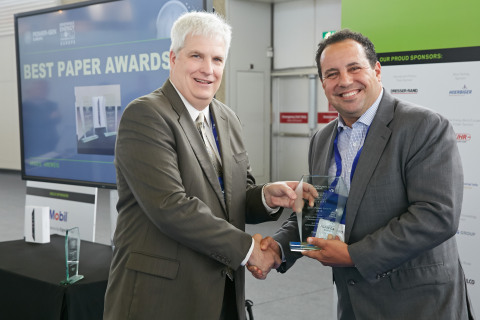 """Richard G. Baker, Senior Vice President, Power Division of PennWell, presents """"Best Paper"""" award to Ener-Core's CEO, Alain Castro at Power-Gen Europe last week. (Photo: Business Wire)"""
