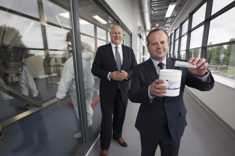 Jim Carswell (right), operations & site leader for Thermo Fisher Scientific's new site in Inchinnan, Scotland, shows off the manufacturer's product: Gibco Advanced Granulation Technology media. The product is an animal-origin free, single-component and particulate-free powder that can reduce the number of components necessary in cell culture manufacturing. Also pictured is Mark Smedley, president & EMEA General Manager for Life Sciences Solutions at Thermo Fisher. (Photo: Business Wire)