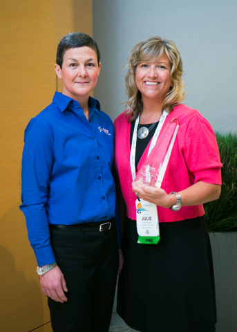 CJ McCarron, vice president of technical support for Tyler's ERP & School Division, presents a Tyler Excellence Award to Julie Calloway, department secretary at Boulder City, Nevada. (Photo: Business Wire)