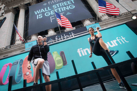 Celebrity trainer and Fitbit (NYSE: FIT) brand ambassador Harley Pasternak, and celebrity client Jordana Brewster, lead a workout session outside the NYSE to celebrate Fitbit's IPO. (Photo: Business Wire)