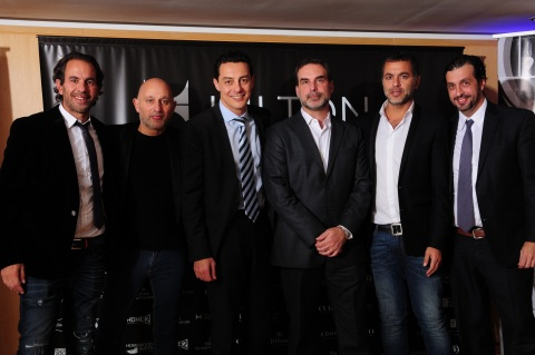 Left to Right: On June 18, 2015, Sebastian Janin and Daniel Souze, partners, Anselmo Buenos Aires; Eduardo Rodriguez Suarez, Director, Development – Southern Cone, Hilton Worldwide; Alejandro Schiavi, Chief of Cabinet, Argentina's Ministry of Tourism; Fernando Janin, partner, Anselmo Buenos Aires; and Carlos Alonso, managing director, PKF hotelexperts Latin America gather to celebrate a signing agreement to add Anselmo Buenos Aires to the Hilton Worldwide's Curio – A Collection by Hilton portfolio, the young brand's first hotel in Latin America. (Photo: Business Wire)