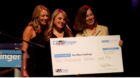 Michelle Sommer, PMC, accepting the Publicity Club of New England's collection of donations from Karyn Martin, president, and Jenny Johnson, host from NESN of the 47th Annual Bell Ringer Awards. (Photo: Business Wire).