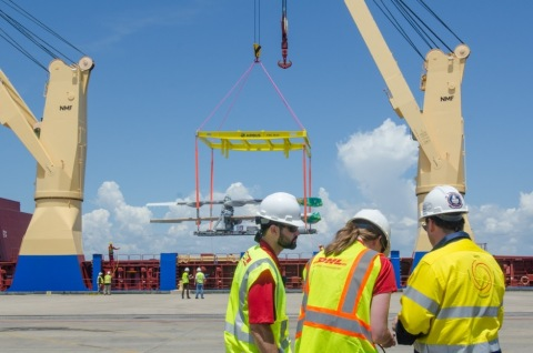 (From left to right) Corey Greene, Project Manager, DHL Global Forwarding Industrial Projects; Meghan Toone, Project Manager, DHL Global Forwarding Industrial Projects and William Cummins, Global Head of Health, Safety and Environment, DHL Global Forwarding Industrial Projects oversee the unloading of Airbus A320 aircraft components in Mobile, Alabama. (Photo: Business Wire)