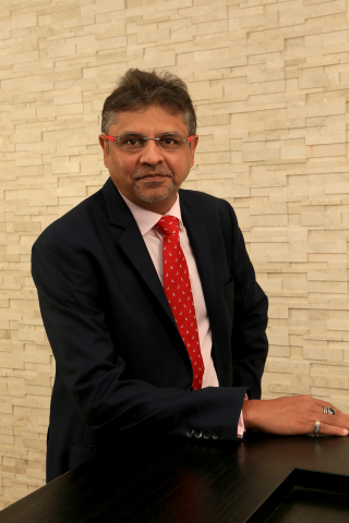 Harry Gandhi, founder and chief executive of Unique Group (Photo: Business Wire)