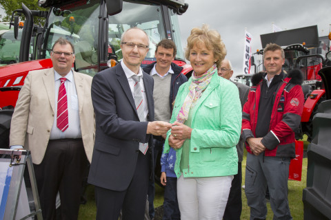 Laurent Pernin - Director, Sales MF, Europe & Turkey hands the keys of a MF 5610 Antarctica2 Special Edition tractor to winner Nancie Clanachan at the Royal Highland Show 2015. Left to right: Campbell Scott - Massey Ferguson Director Marketing Services, Laurent Pernin - Director, Sales MF, Europe & Turkey, Stuart Clanachan, Nancie Clanachan, Donald Clanachan, Simon Foster - Antarctica2 Creative Director and Audio-Visual Lead (Photo: Business Wire)