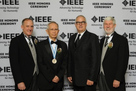 """Dr. Takuyo Aoyagi (second from left), senior manager at Nihon Kohden, receives the 2015 Institute of Electrical & Electronic Engineers (IEEE) """"Medal for Innovations in Healthcare Technology,"""" for changing the face of modern surgery with the invention of pulse oximetry. Considered the most important lifesaving practice during surgery by the World Health Organization, pulse oximetry is recognized as the standard of care for the assessment of oxygenation, spanning virtually every domain of medical practice. Dr. Aoyagi is joined in the picture by (left to right) IEEE President-Elect Barry Shoop, IEEE EMB President Andrew Laine and IEEE President Howard Michel. (Photo: Business Wire)"""