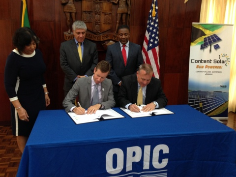 WRB Enterprises Chairman and CEO G. Robert Blanchard Jr. (right) and OPIC Chief of Staff John Morton ...