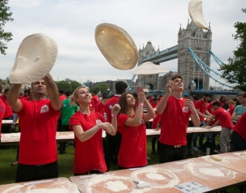 Papa John's employees get stuck in tossing pizza dough as they officially break the GUINNESS WORLD R ...