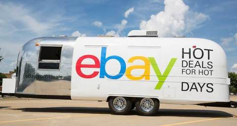 """eBay's """"Hot Deals for Hot Days"""" Airstream experience invites shoppers to browse and buy new designer sunglasses at a discount that mirrors the high temperature of the day: 85 degrees means shoppers get 85 percent off their new summer essential. The eBay Deals Airstream will make its debut in the Hamptons on July 4 and then travel to New York City's Flatiron Plaza July 7 and July 8. (Photo by Shannon Faulk/AP Images for eBay)"""