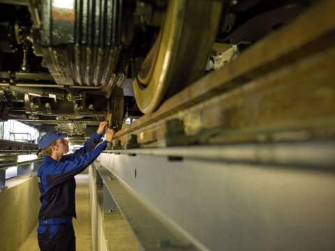 A Siemens service technician examines an operating system on a rail locomotive. (Photo: Business Wir ...