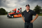Schneider driver (and Ontario resident) Darrell Esson stands in front of the new Ride for Pride truck. (Photo: Business Wire)
