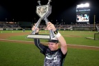 2015 TD Ameritrade College Home Run Derby winner Jeff Campbell of the University of North Dakota, hoists his trophy at the conclusion of the competition. Photo courtesy of Green Room Studios. (Photo: Business Wire)
