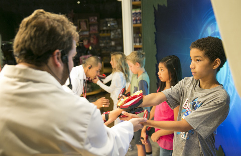 Kids playing with Playmation Marvel's Avengers at Disney Store on Tuesday, July 7, 2015 in Glendale, ...